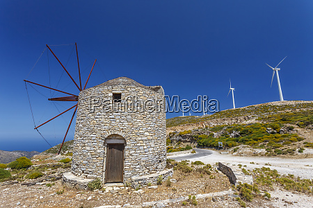 old windmill and modern wind turbines