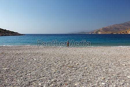 woman at trahili beach chios island