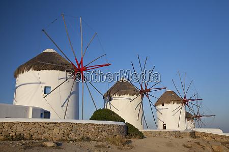 greece mykonos windmills along the water