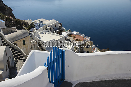 oia santorini greece blue wooden gate
