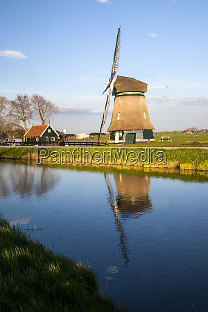 netherlands lisse windmill on a canal
