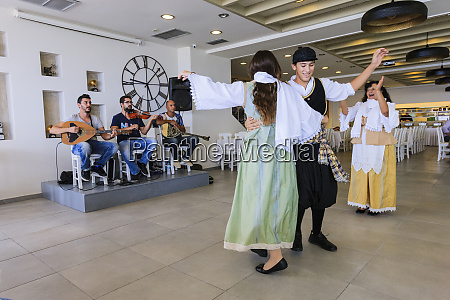 traditional greek dancers entertain tourists santorini