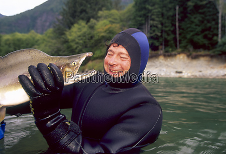 scientist holding large chinook salmon vancouver
