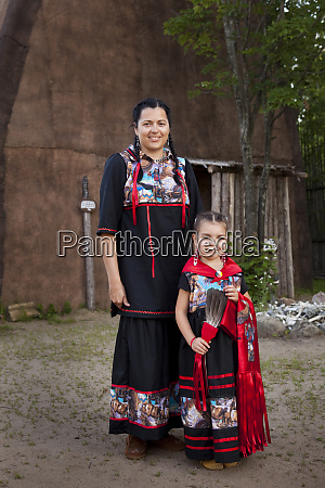 ojibwe mother and daughter dressed in