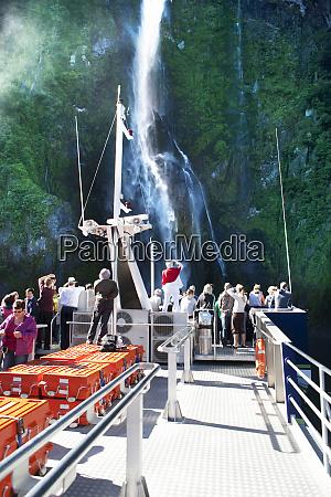 tour boat exploring new zealands milford