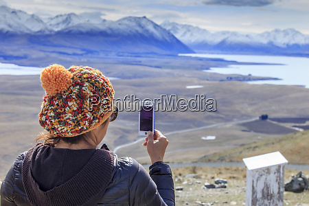 a woman taking a panorama of