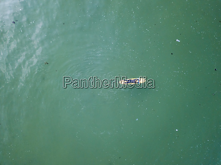 aerial view of a surfer over
