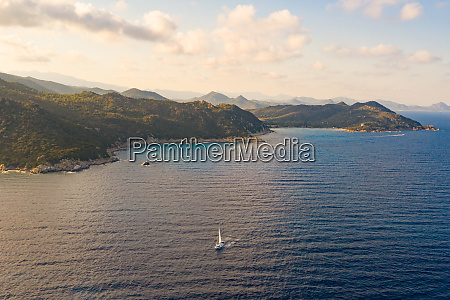 aerial view of boat sailing along