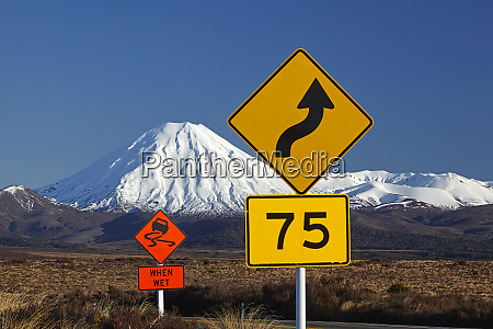 road signs on desert road and