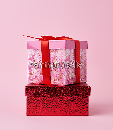 square cardboard pink box tied with