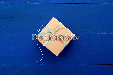 brown cardboard gift square box on