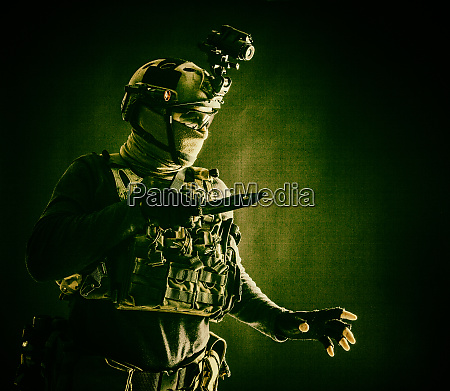 commando fighter creeping in darkness with