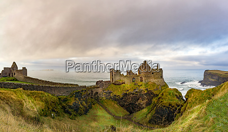 ruins of dunluce castle on the
