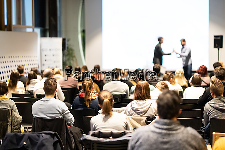 business speakers giving a talk at
