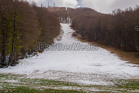 ski slope with little snow