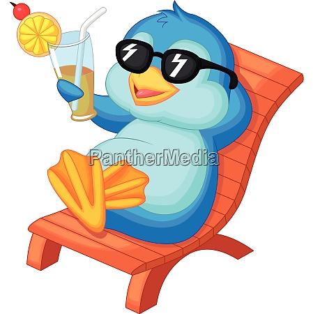cute penguin sitting on beach chair