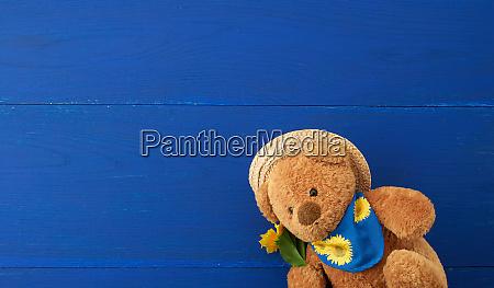 beige teddy bear sitting on a