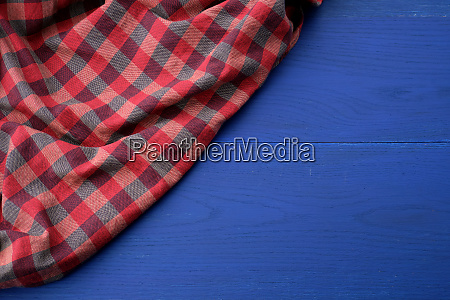 red checkered fabric on a blue