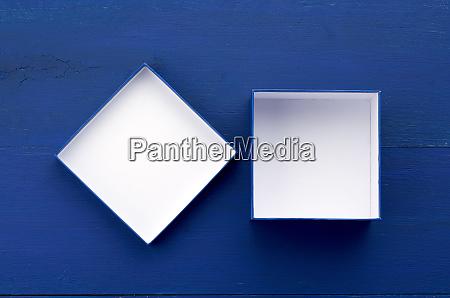 open empty square cardboard box for