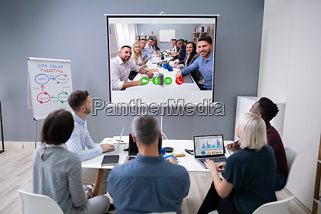 colleague doing video conferencing in office