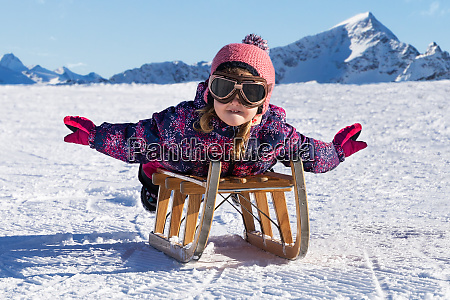 kid sliding with sledge in the