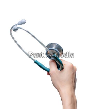 hand holding stethoscope isolated on white