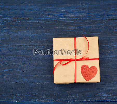 brown box with a gift and
