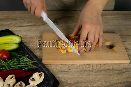 chef cutting chicken fillet making chicken