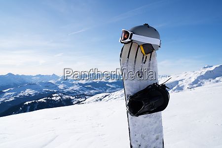 winter sports equipment against mountains