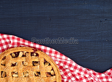 round traditional baked cherry pie on