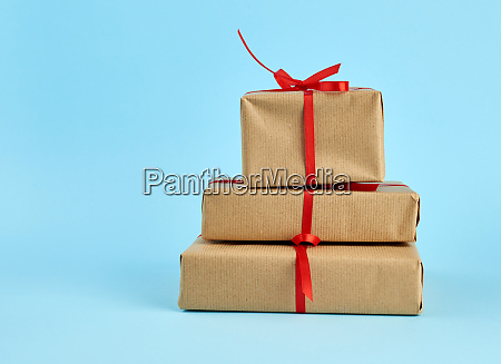 stack of boxes wrapped in brown
