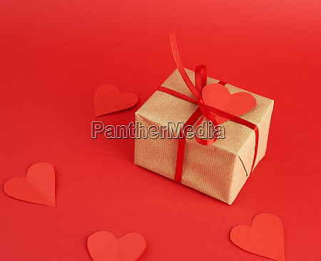 wrapped square box with a gift