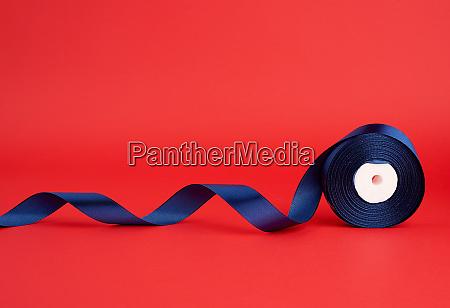 spool of twisted dark blue silk