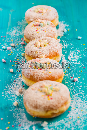 carnival powdered sugar raised donuts