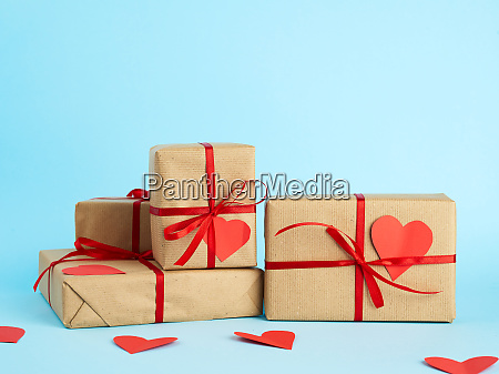 stack of wrapped gifts in brown