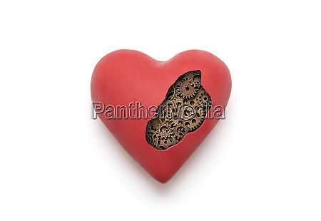 red mechanical heart over white background