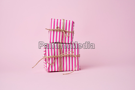 two boxes wrapped in pink paper