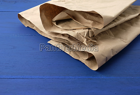 brown crumpled kraft paper sheet on