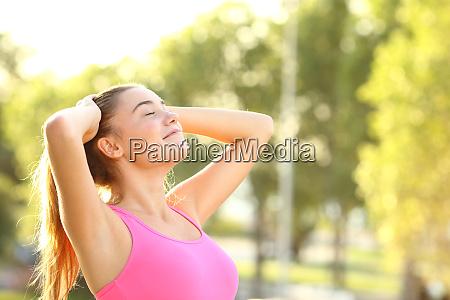 satisfied runner woman breathing fresh air