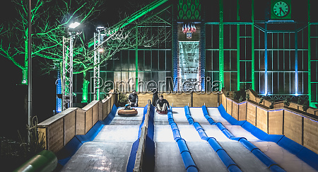 children, and, adults, tobogganing, on, an - 27959718