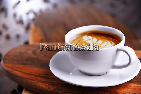 composition with cup of caffe latte
