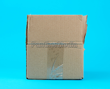 open brown cardboard box on a