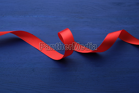 red, silk, thin, ribbon, twisted, on - 27962562
