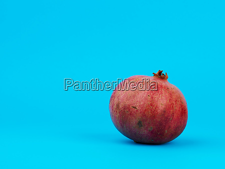 ripe, red, pomegranate, in, a, peel - 27962507