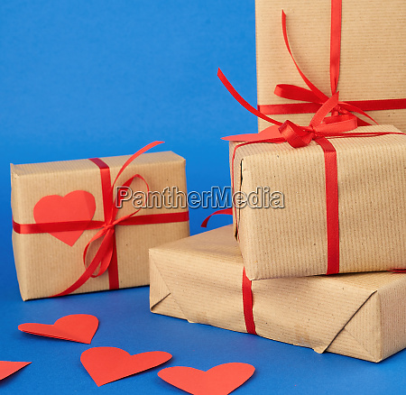 stack, of, wrapped, gifts, in, brown - 27962530
