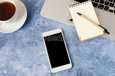 white smartphone with black blank screen