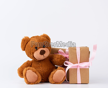 brown teddy bear stack of gifts