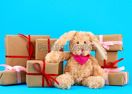 cute little brown plush rabbit and