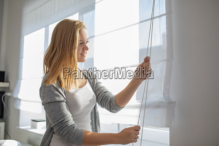 pretty young woman lowering the interior