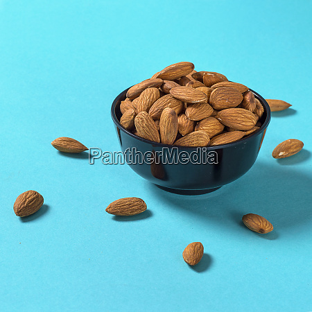 close up of almonds on blue